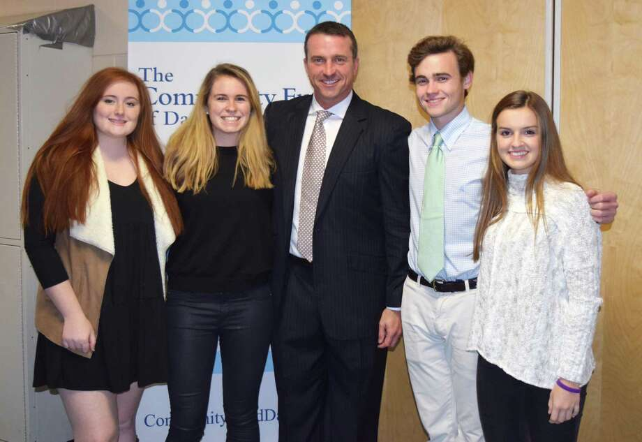 Chris Herren, a former NBA star and recovered addict who spoke at Darien High School Nov. 30, poses with Youth Asset Team Presidents Olivia Taylor, left, Emma Dahlquist, Will Harman and Sydney Schrenker. Photo: Contributed Photo