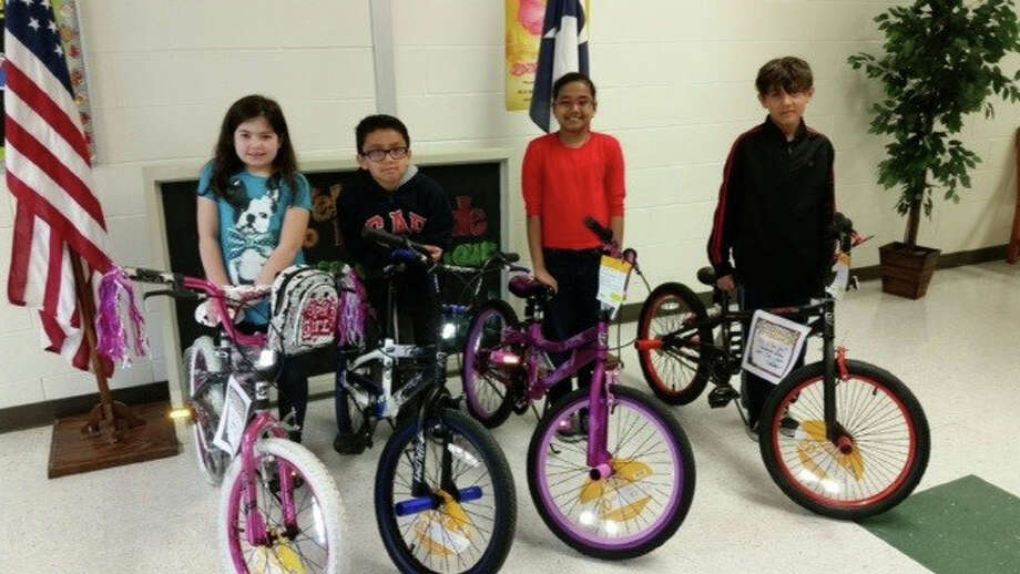 Four Cleveland students with perfect attendance received an extra Christmas gift this year courtesy of State Farm Agent Scott Shuff. Each was given a new bike as a reward for their attendance. Pictured left to right are third-graders Makayla Rivera and Fernando Vazquez, and fourth-graders Mahima Krishna and Adan Lira. Photo: Submitted