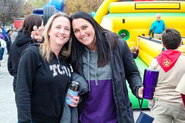 Cold weather didn't deter dueling TCU and Stanford fans attending pre-Alamo Bowl festivities at Sunset Station on Thursday, Dec. 28, 2017. The Valero Alamo Bowl fan zone offered games, food trucks and music as attendees waited for kick-off