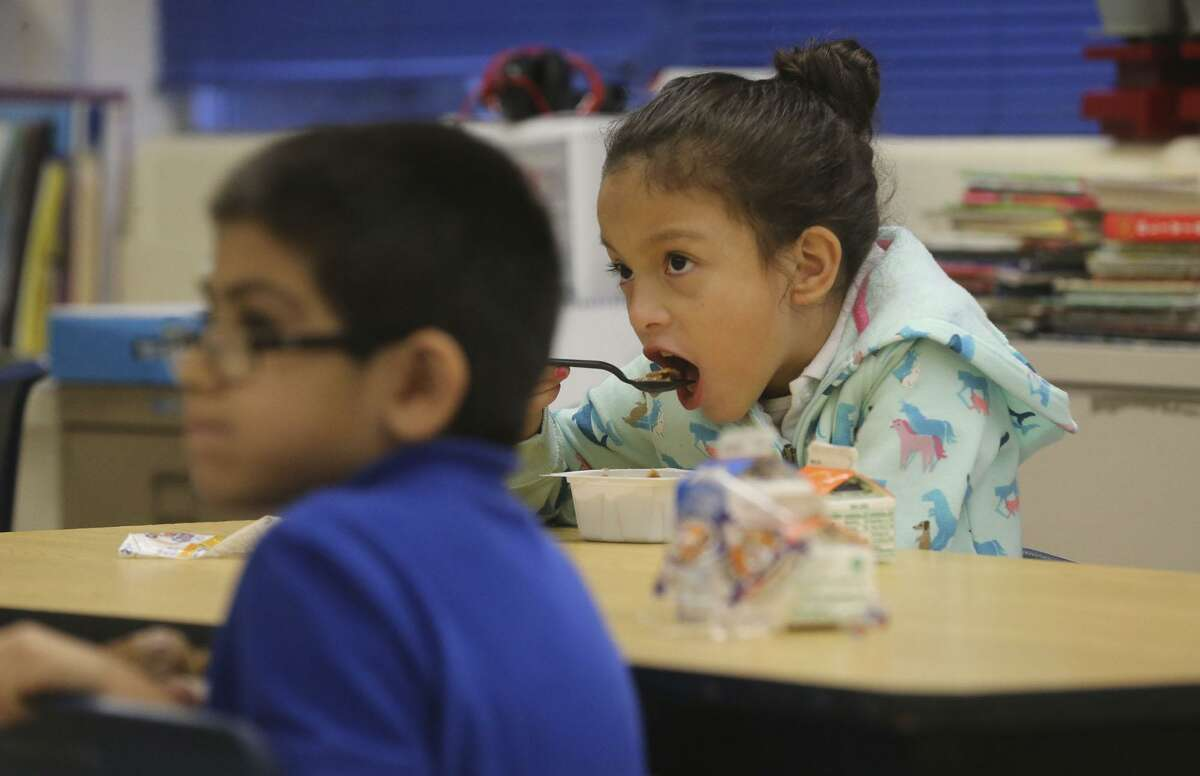 Maddie Ortega,7, eats cereal Wednesday morning December 20, 2017 in her classroom at De Zavala Elementary school on San Antonio's West Side. The San Antonio Independent School District is ranked highly statewide for its school food program, mostly due to serving breakfast in class which drives student participation rates higher.