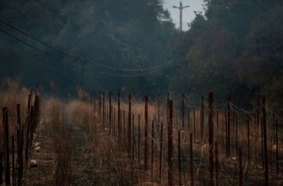 A burned out area off Soda Canyon Road Oct. 9, 2017 in Napa, Calif. A fire tore through the area on the evening of Oct. 8, destroying properties and vineyards. Photo: Leah Millis, Staff / Leah Millis/ The Chronicle