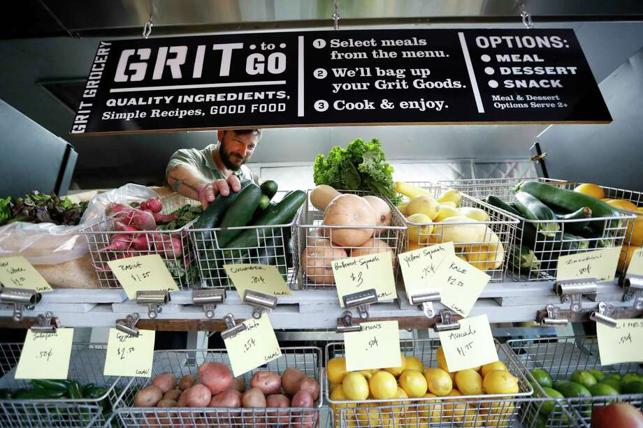 Dustin Windham at Grit Grocery, the mobile farmers market he founded in 2015. Photo: Karen Warren, Houston Chronicle / @ 2017 Houston Chronicle