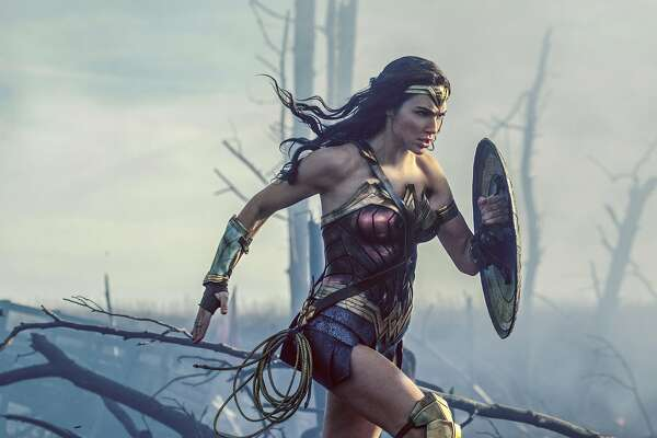"FILE - This file image released by Warner Bros. Entertainment shows Gal Gadot charging through No Man's Land during a WWI battle scene from ""Wonder Woman."" After two consecutive record-breaking years at the domestic box office, 2017 was the year the momentum slowed, even with the late adrenaline boost of a new ""Star Wars"" film. This is Disney's second consecutive year at the top of the charts. Warner Bros. placed second with around $2 billion in grosses and 19 percent of the market share, thanks to films like ""Wonder Woman,"" ""It"" and ""Get Out."" (Clay Enos/Warner Bros. Entertainment via AP, File)"