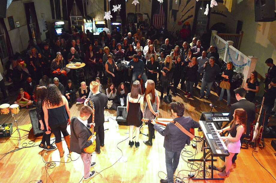 The house band from School of Rock in Fairfield performs at Toquet Hall during First Night Westport, which took place downtown, Saturday, Dec. 31, 2016, in Westport, Conn. Photo: Jarret Liotta / For Hearst Connecticut Media / Westport News Freelance