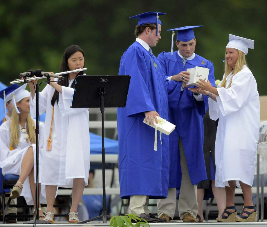 As Tianjia Du plays a musical tribute as friends of Jacob Velasco-Navarro and JR Schoen release butterflies in remembrance of their classmates during Darien High School Class of 2017 Commencement Exercises at the school in Darein, Conn., on Friday, June 16, 2017. Photo: Matthew Brown / Hearst Connecticut Media / Stamford Advocate