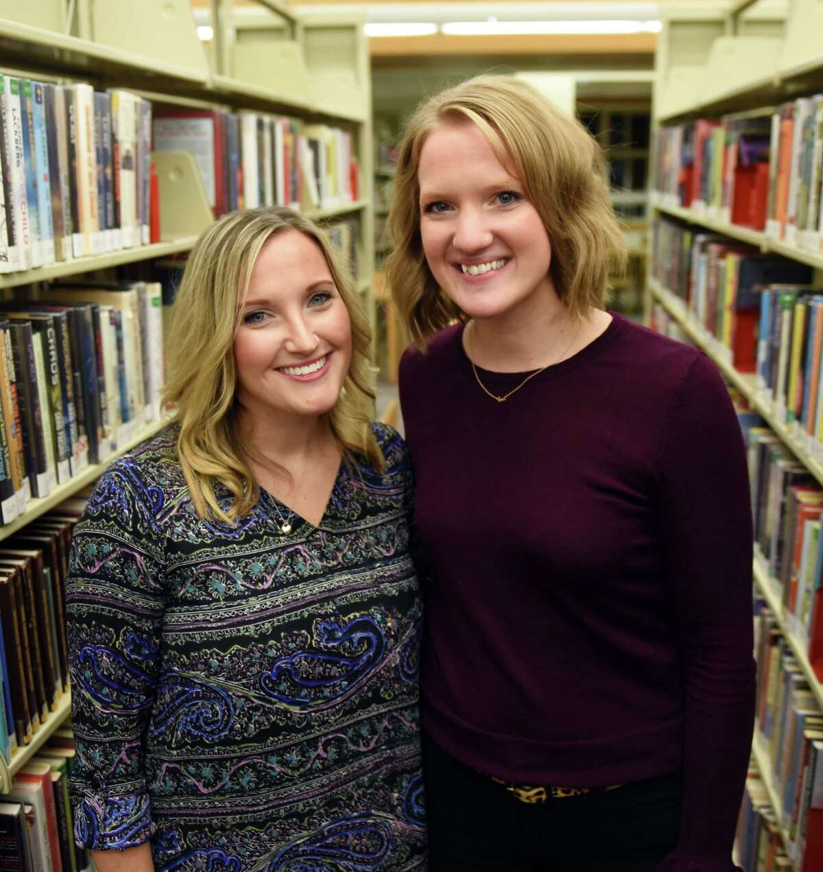 Val Santillo, left, with her sister Alison Krawczyk, right, at the Niskayuna Library on Wednesday, Nov. 15, 2017, in Niskayuna, N.Y. Alison is inspired by her sister, Val, a first-grade teacher at Red Mill Elementary. (Will Waldron/Times Union)
