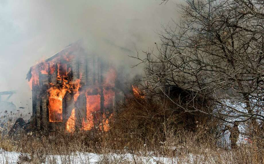 A multi alarm-fire consumes the structure at 492 Font Grove Road on Friday, Dec 29, 2017, in Bethlehem, N.Y. (Skip Dickstein/ Times Union) Photo: SKIP DICKSTEIN, Albany Times Union