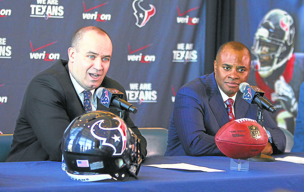 Houston Texans Head Coach Bill O'Brien and General Manager Rick Smith announce the coach's hiring on Friday, January 3, 2014.