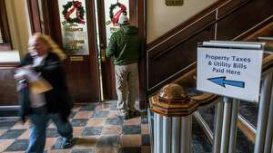 Homeowners line up to pay their property taxes to beat the New Year deadline for a tax right off at City Hall Friday Dec 29, 2017 in   Saratoga Springs, N.Y.  (Skip Dickstein/ Times Union)