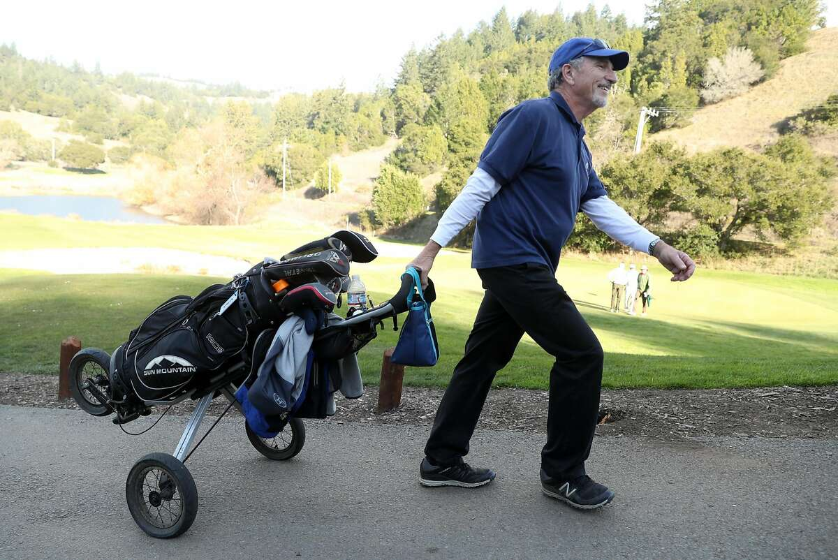 Tom Faimali of San Rafael leaves the 18th green after completing his round at San Geronimo Golf Course in San Geronimo, Calif., on Monday, December 18, 2017.