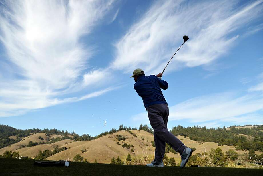 Dana Scott tees off at San Geronimo Golf Course's 10th hole, known for its panoramic view of hills and trees. Photo: Scott Strazzante, The Chronicle
