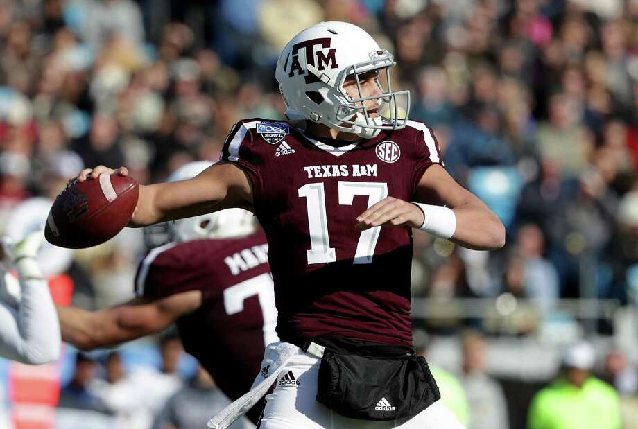 CHARLOTTE, NC - DECEMBER 29:  Nick Starkel #17 of the Texas A&M Aggies drops back to pass against the Wake Forest Demon Deacons during the Belk Bowl at Bank of America Stadium on December 29, 2017 in Charlotte, North Carolina. Photo: Streeter Lecka, Getty Images / 2017 Getty Images