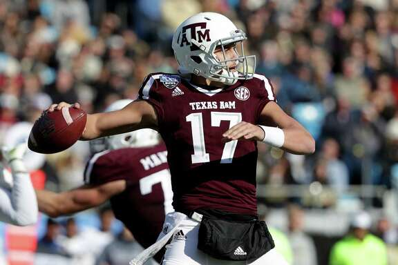 CHARLOTTE, NC - DECEMBER 29:  Nick Starkel #17 of the Texas A&M Aggies drops back to pass against the Wake Forest Demon Deacons during the Belk Bowl at Bank of America Stadium on December 29, 2017 in Charlotte, North Carolina.