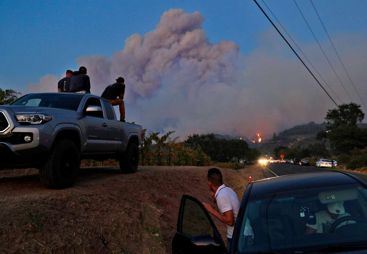 Members of the community watch as a fire grows along the ridge neaer Highway 12 outside Eldridge, Calif., on Tuesday, October 10, 2017. The Napa and Sonoma valleys continue to be under threat from several fires as some communities begin to assess the impact of the fires.