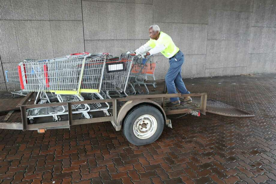 Barnett Small picks up stray shopping carts from under a overpass at Main and Hillcroft Ave. Tuesday, Dec. 19, 2017, in Houston. He picks up carts in medians, ditches and sidewalks in two city council districts. ( Steve Gonzales / Houston Chronicle ) Photo: Steve Gonzales, Houston Chronicle / © 2017 Houston Chronicle