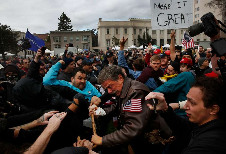 Tom Condon of San Francisco, a Trump supporter, becomes entangled in the center of a fight after attempting to push anti-fascist protesters back with his cane during a Pro-President Donald Trump rally and march at the Martin Luther King Jr. Civic Center park March 4, 2017 in Berkeley, Calif.