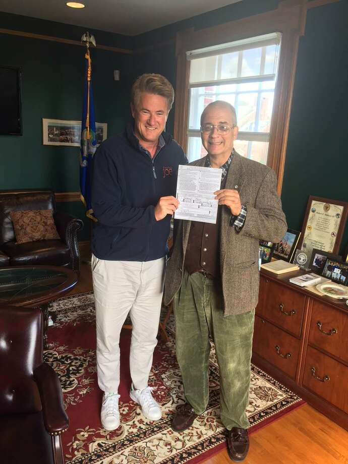 Joe Scarborough with New Canaan's unaffiliated Registrar of Voters John Amarilios after changing his party affiliation on Oct. 12, 2017 in New Canaan, Conn. Photo: Contributed / Hearst Connecticut Media / New Canaan News