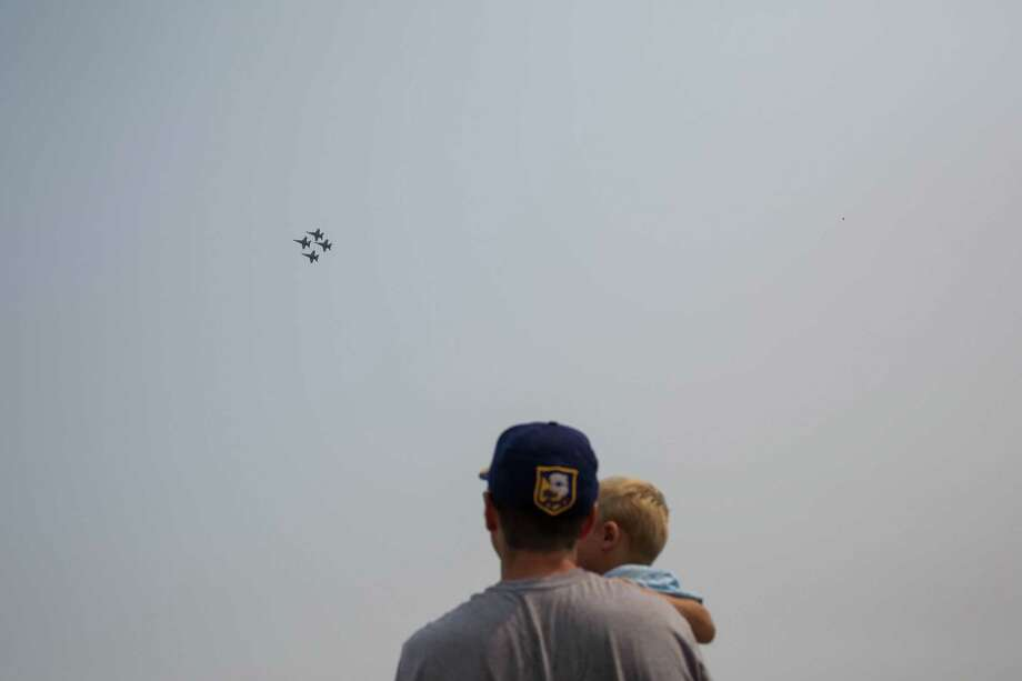David Chernicoff and his son Dylan, 1, watch the Blue Angels perform from the Interstate 90 bridge over Lake Washington on the last day of Seafair, Aug. 6. Photo: GRANT HINDSLEY/SEATTLEPI.COM
