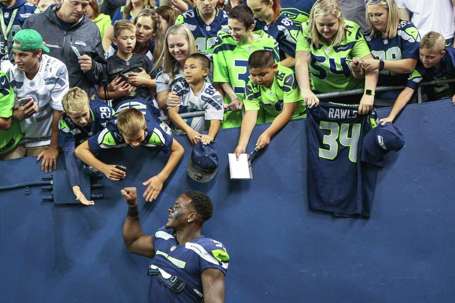 Seahawks defensive lineman Frank Clark greets fans following the Seahawks' 20-13 win over the Minnesota Vikings in a preseason game at CenturyLink Field on Aug. 18. Photo: GRANT HINDSLEY/SEATTLEPI.COM