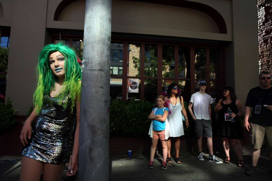 """RainbowGore Cake waits to compete in a drag competition at Capitol Hill Pridefest hosted by The Boulet Brothers, June 24, 2017.  As the self-styled """"America's Youngest Drag Superstar,"""" SailorHank Payne first began creating his drag persona, RainbowGore Cake, at age 8. Now 14 and starting high school in the fall, RainbowGore Cake has become a full-fledged character with growing notoriety. She has performed across the country— Austin, San Francisco, Portland and New Orleans— in shows and festivals. (Genna Martin, seattlepi.com) Photo: GENNA MARTIN/SEATTLEPI.COM"""