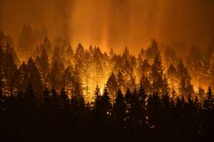 The Eagle Creek Fire continues to burn on the Oregon side of the Columbia River Gorge near Cascade Locks and the Bridge of the Gods, late Tuesday, Sept. 5, 2017. (Genna Martin, seattlepi.com)