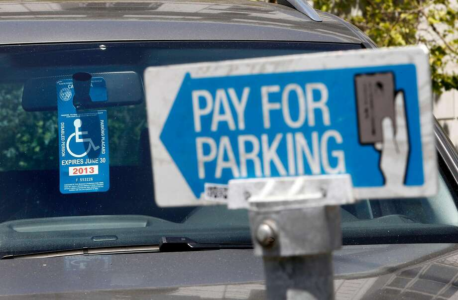 A disabled placard in a parked San Francisco car in 2013. A new law cracks down on placard fraud and abuse, which state studies suggest is rampant. Photo: Michael Macor, The Chronicle