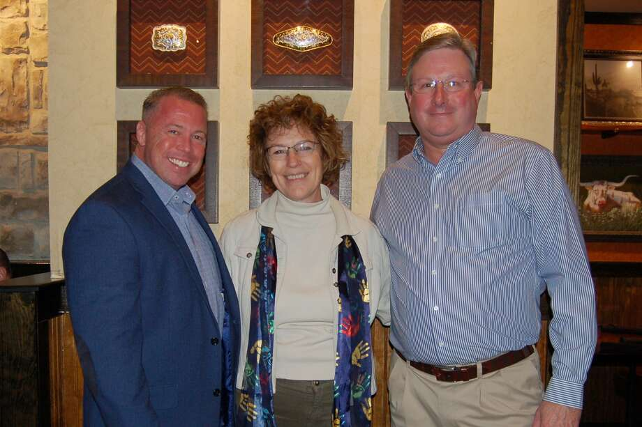 Pictured from left are: Precinct 3 Constable Ryan Gable; Victoria Constance, MSPH, PhD, Executive Director and CEO of the Board of Directors for Children's Safe Harbor; and Billy Banks, Managing Partner, Longhorn Steakhouse.