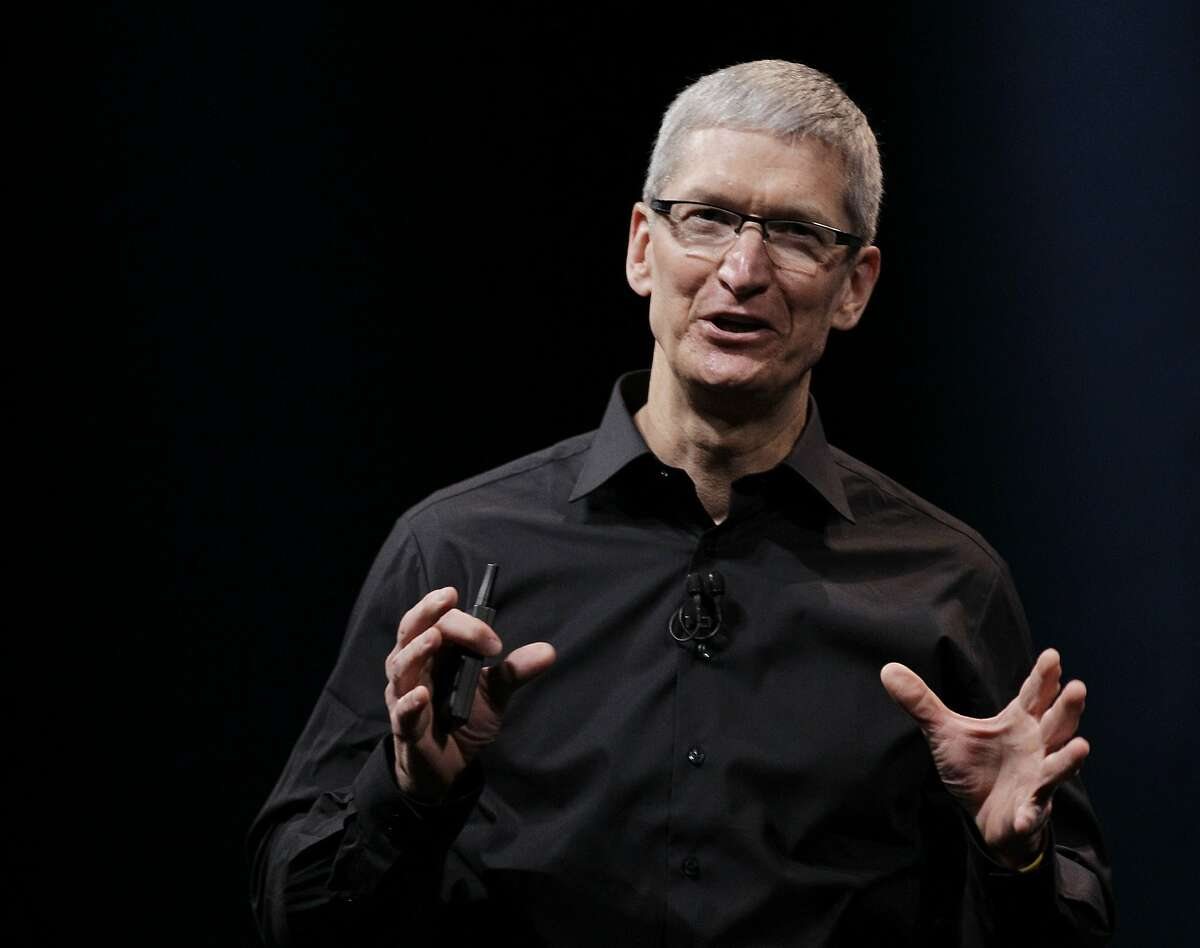 In this Wednesday, Sept. 12, 2012 photo, Apple CEO Tim Cook speaks during an introduction of the new iPhone 5 in San Francisco. Cook recently said Apple TV would not remove the NRAtv channel from its App Store.
