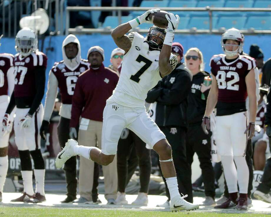 Wake Forest's Scotty Washington (7) catches a touchdown pass against Texas A&M during the first half of the Belk Bowl NCAA college football game in Charlotte, N.C., Friday, Dec. 29, 2017. (AP Photo/Chuck Burton) Photo: Chuck Burton, Associated Press / Copyright 2017 The Associated Press. All rights reserved.