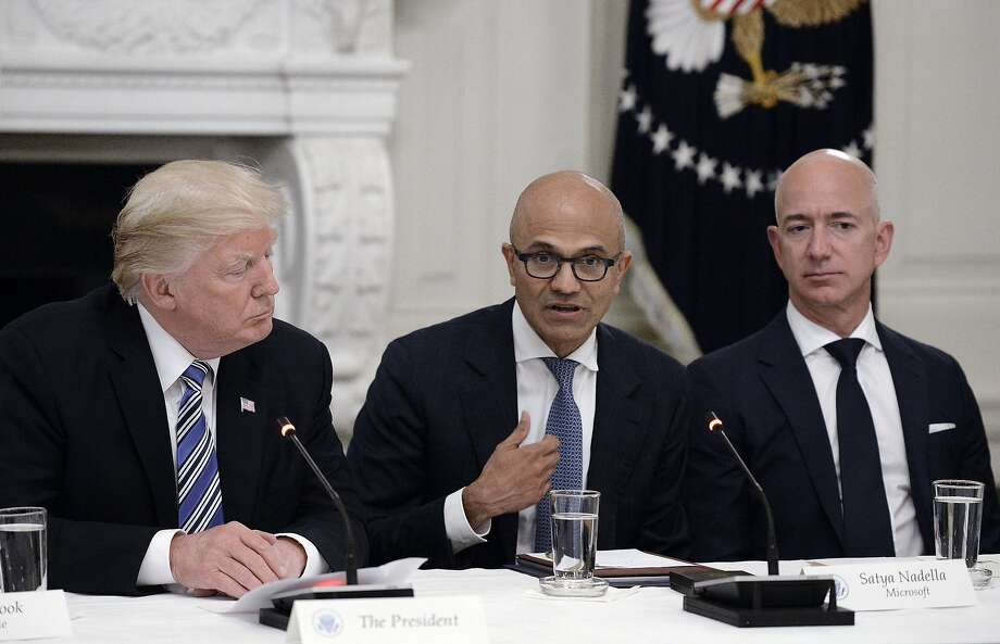 From left, U.S. President Donald Trump, Microsoft CEO Stya Nadella and Amazon CEO Jeff Bezos attend a meeting of the American Technology Council on Monday, June 19, 2017 in the State Dining Room of the White House in Washington, D.C. Photo: Olivier Douliery, TNS