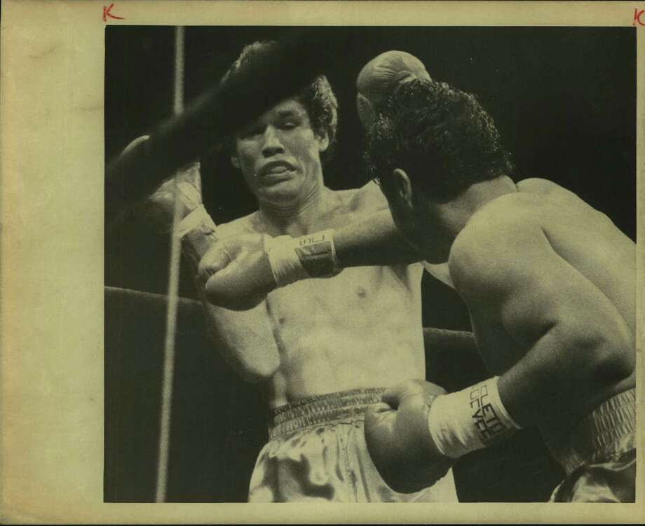 San Antonio boxer Tony Ayala Jr. (right) pounds Robbie Epps, dispatching him in the first round on Aug. 1, 1980, in Freeman Coliseum. Two readers found Ayala to be a troubling subject for a recent article marking the city's Tricentennial. Photo: File Photo / San Antonio Express-News / San Antonio Express-News