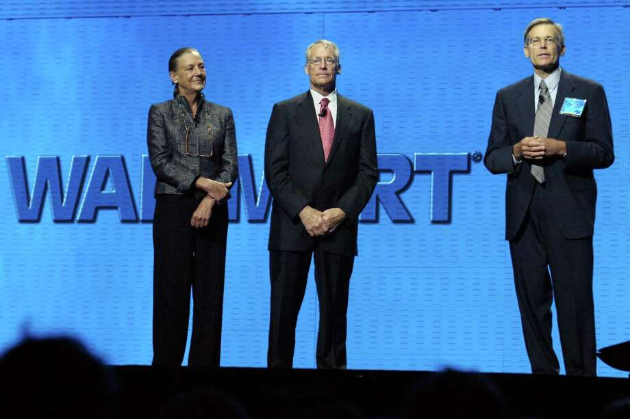 Alice Walton (from left), Rob Walton and Jim Walton, children of Walmart founder Sam Walton, speak during the annual a shareholder's meeting in in 2008. They have remained active in the company and in community affairs. Many heirs to fortunes possess an inner drive that overwhelms any desire for perpetual leisure. Photo: File Photo / Associated Press / FR81294