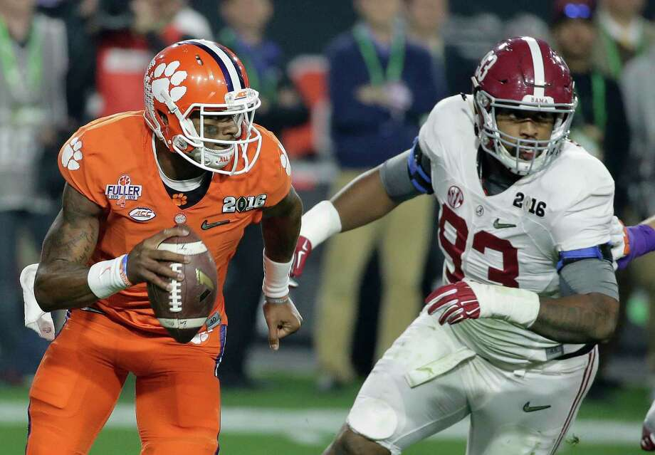 FILE - In this Jan. 11, 2016, file photo, Clemson quarterback Deshaun Watson, left, tries to get away from Alabama's Jonathan Allen during the first half of the NCAA college football playoff championship game in Glendale, Ariz. Clemson and Alabama will meet Monday in the College Football Playoff for the third straight year when they square off in the Sugar Bowl. After finishing third in the Heisman voting, Watson passed for 405 yards and four touchdowns against 'Bama while running for 73 yards in the 2016 game. (AP Photo/Chris Carlson, File) Photo: Chris Carlson, STF / Copyright 2017 The Associated Press. All rights reserved.