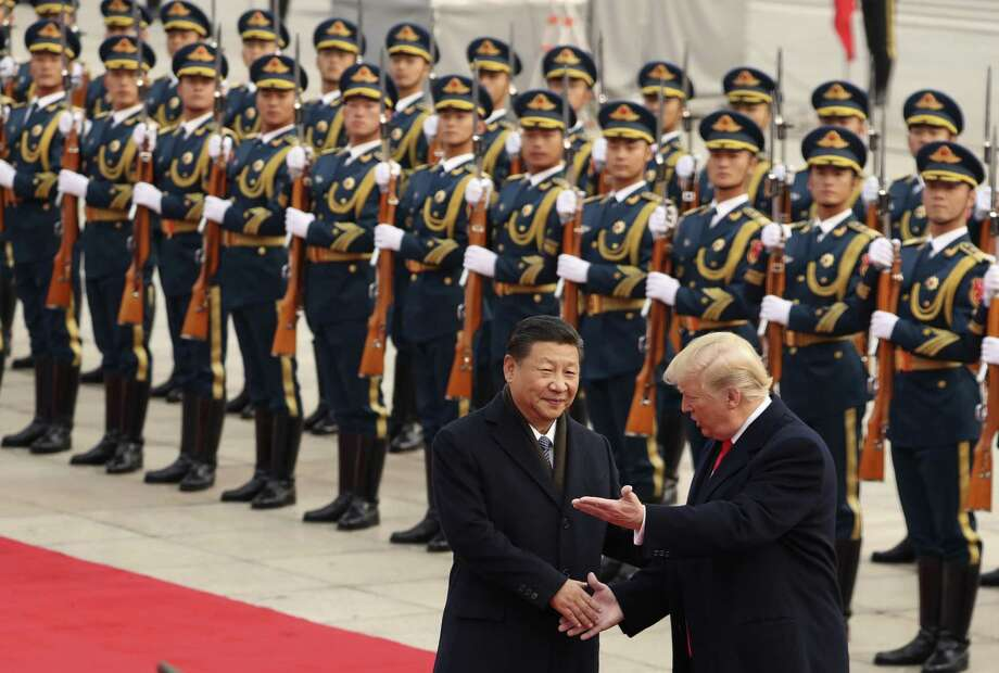 President Donald Trump and Chinese President Xi Jinping participate in a welcome ceremony at the Great Hall of the People in Beijing, China. Perhaps indicating a desire to isolate the country, Trump has yet to reciprocate in kind. He will close his first year in office without holding a state dinner for a foreign head of state. Photo: Andrew Harnik /Associated Press / Copyright 2017 The Associated Press. All rights reserved.