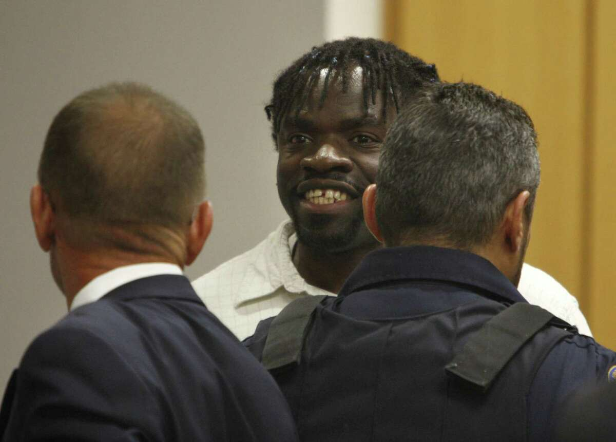 Death row inmate Marcus Robinson smiles after Cumberland County Senior Resident Superior Court Judge Greg Weeks found, on April 20, 2012, in Fayetteville, North Carolina, that racial bias played a role in his trial and sentencing.
