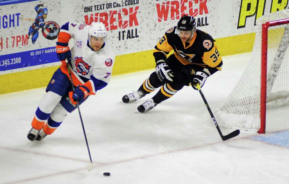 Wilkes-Barre/Scranton's Ryan Haggerty, right, tracks Sound Tigers Devon Toews behind the goal during AHL hockey action at the Webster Bank Arena in Bridgeport, Conn. on Saturday Dec. 16, 2017. Photo: Christian Abraham / Hearst Connecticut Media / Connecticut Post