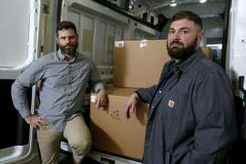 In this Dec. 26, 2017, photo, Old Kai Distribution cofounders Matthew Mandelker, right, and Lucas Seymour, who are licensed cannabis distributors, pose for a photo beside a delivery van loaded with product at their warehouse near Ukiah, Calif. Workers for the company were transporting the marijuana from a cultivator when they were pulled over Friday by a California Highway Patrol officer, according to Joe Rogoway, an attorney for the company. The workers showed the officer the company�s cannabis license and a manifest for the marijuana, but the officer insisted it was illegal, called for backup and arrested the men. (Alvin Jornada/The Press Democrat via AP)
