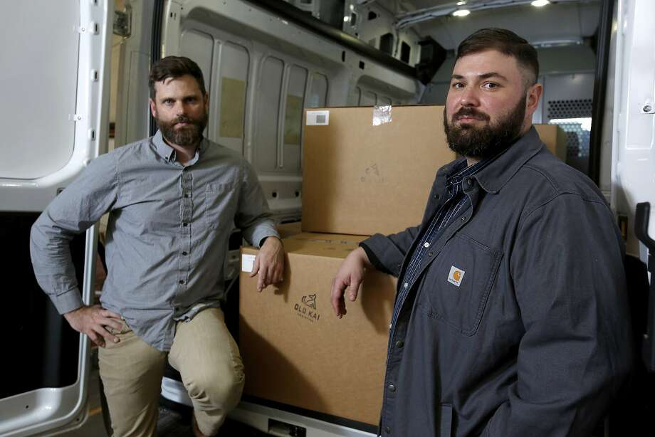 Lucas Seymour (left) and Matthew Mandelker of Old Kai Distribution are trying to recover the pot seized by the CHP. Photo: Alvin Jornada, Associated Press