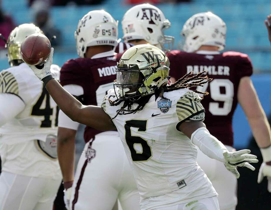 Wake Forest's Jaboree Williams (6) recover a Texas A&M fumble during the first half of the Belk Bowl NCAA college football game in Charlotte, N.C., Friday, Dec. 29, 2017. (AP Photo/Chuck Burton) Photo: Chuck Burton, STF / Copyright 2017 The Associated Press. All rights reserved.