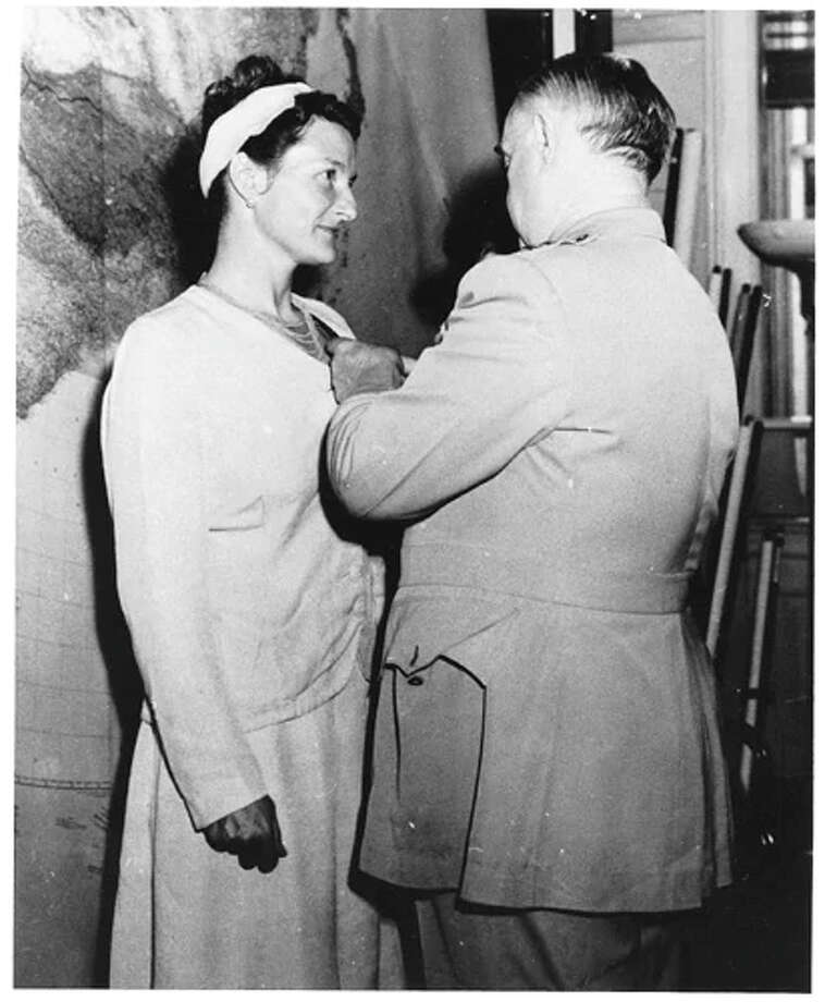 Virginia Hall is awarded the Distinguished Service Cross by Gen. William Donovan, chief of Office of Strategic Services in 1945. Photo: Courtesy Of Erik Kirzinger. / Courtesy of Erik Kirzinger