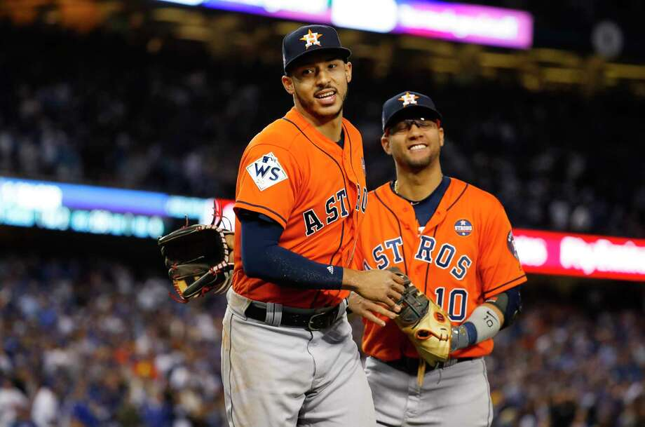 Houston Astros shortstop Carlos Correa (1) and first baseman Yuli Gurriel (10) come back to the Astros dugout at the end of the sixth inning of Game 7 of the World Series at Dodger Stadium on Wednesday, Nov. 1, 2017, in Los Angeles. ( Karen Warren  / Houston Chronicle ) Photo: Karen Warren, Houston Chronicle / © 2017 Houston Chronicle
