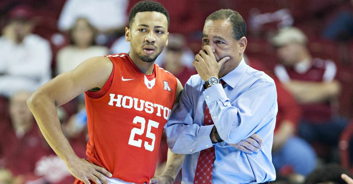 FAYETTEVILLE, AR - DECEMBER 6: Galen Robinson Jr. #25 talks with Head Coach Kelvin Sampson of the Houston Cougars during a game against the Arkansas Razorbacks at Bud Walton Arena on December 6, 2016 in Fayetteville, Arkansas. The Razorbacks defeated the Cougars 84-72. (Photo by Wesley Hitt/Getty Images)