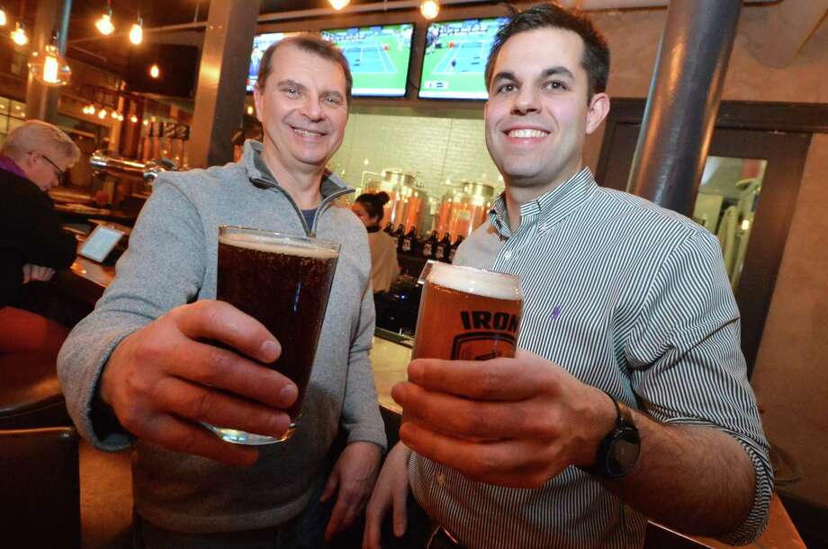 Brewer John Commander and Brewer, General Manager, Shane Nunes have a tase of their favorite and the brewery's most popular beers, Belgian Dubbel #2 and Pilot #1 Galaxy at the bar in their Iron Brewing Co.  on Washington St on Thursday December 28, 2017 in Norwalk Conn. Photo: Alex Von Kleydorff / Hearst Connecticut Media / Norwalk Hour
