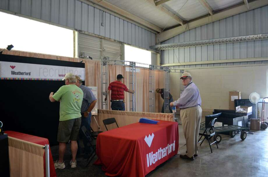 Weatherford's and Big D's employees setting up booths in Building B Monday afternoon in perperation for Tuesday morning's opening ceremonies at the Permian Basin International Oil Show in Ector County. Photo: James Cannon/MRT
