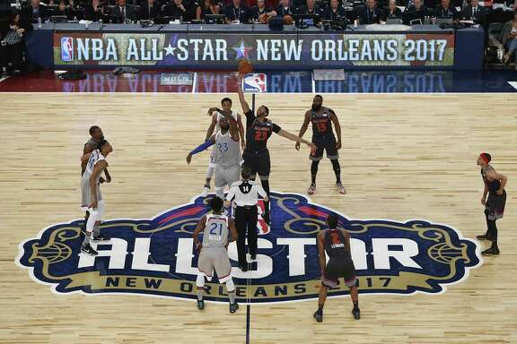 Cleveland's LeBron James (23, left) and New Orleans' Anthony Davis go for the opening tip in last season's All-Star Game, which the West won 192-182.