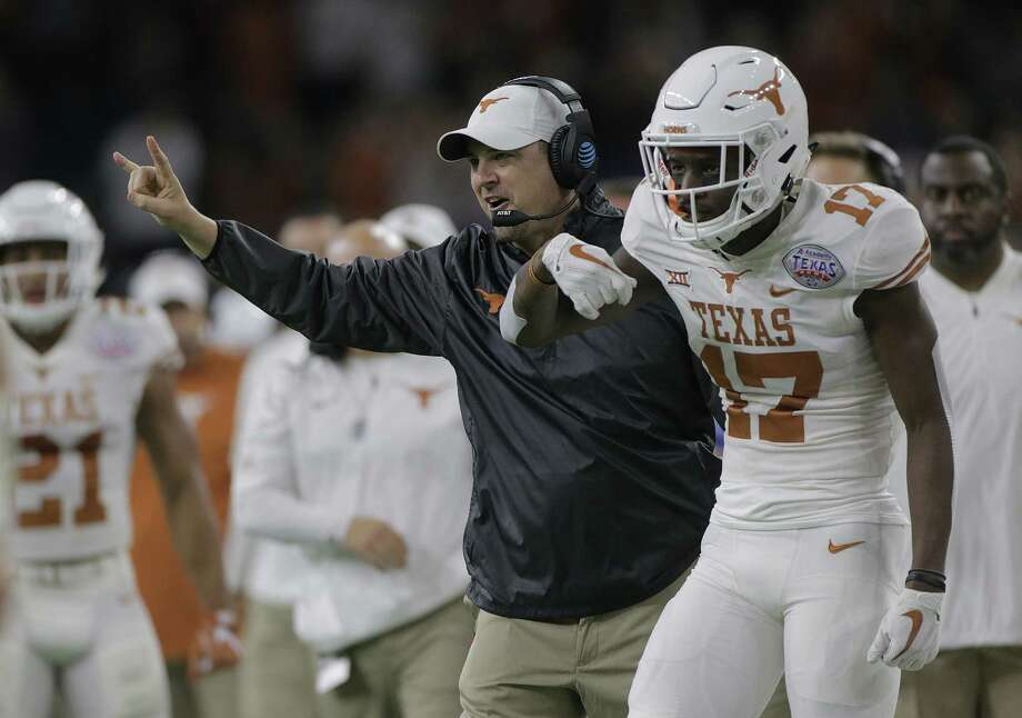 Texas Longhorns head coach Tom Herman celebrates after the team's first touchdown in the first quarter of the The Academy Sports & Outdoors Texas Bowl against Missouri at NRG Stadium on Wednesday, Dec. 27, 2017, in Houston. ( Elizabeth Conley / Houston Chronicle ) Photo: Elizabeth Conley, Chronicle / © 2017 Houston Chronicle