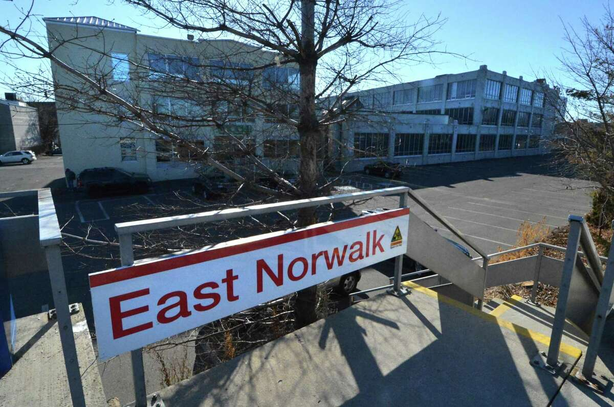 The former Hat Factory Outlet and commuter parking lot, next to the East Norwalk Train Station on Thursday, Dec. 28 in Norwalk.
