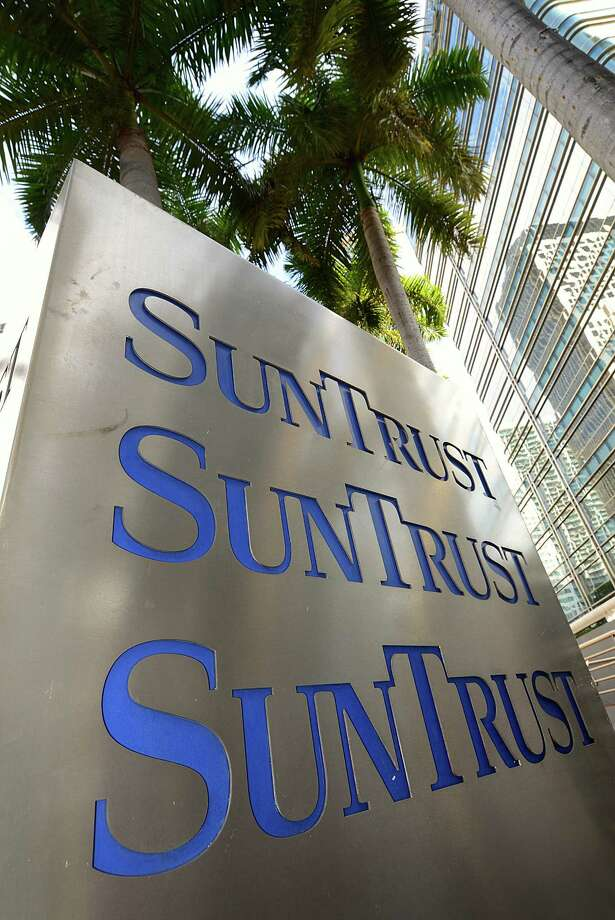 SunTrust Banks Inc. signage is displayed outside of a branch in Miami, Florida, U.S., on Friday, Jan. 13, 2012. Florida will hold its Republican presidential primary on Jan. 31. Photographer: Mark Elias/Bloomberg Photo: Mark Elias / © 2012 Bloomberg Finance LP
