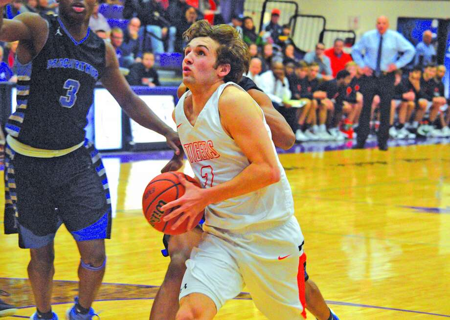 Edwardsville senior Jack Marinko drives to the basket during the first quarter of Friday's quarterfinal game against Decatur MacArthur at the Collinsville Holiday Classic.