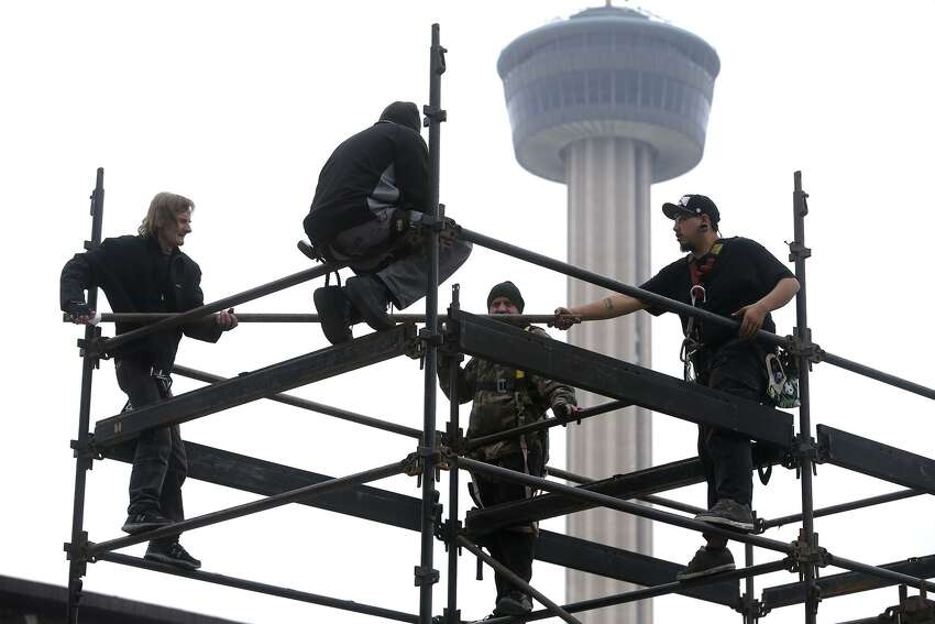 A crew works to erect a structure made of steel pipes Friday, Dec. 29, 2017, at HemisFair near the Henry B. Gonzalez Convention Center. Stages for musical performances, tents and other structures in the area just west of the Convention Center are being assembled for the upcoming New Year's Eve Celebration that will kick off San Antonio's 300th birthday celebration. The event is free and open to the public and opens at 4:00 p.m. . The event will feature interactive art, games, music and live theatrical performances. A wide array of food and drink options will be available.